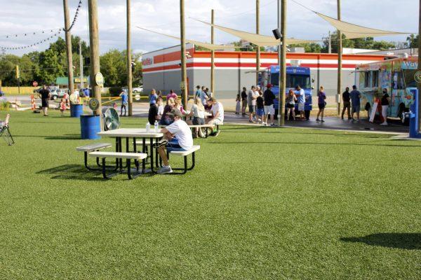 Dinner-goers visit 9 Mile Garden, a food truck garden in Affton, in July 2020.