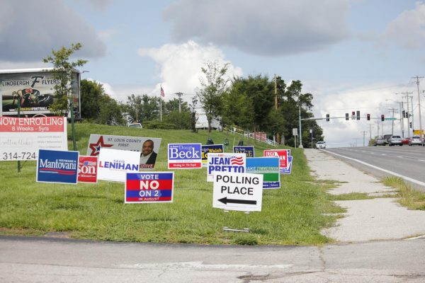 Election signs along the entrance to the polls at Sperreng Middle School along Tesson Ferry Road on Election Day Tuesday.