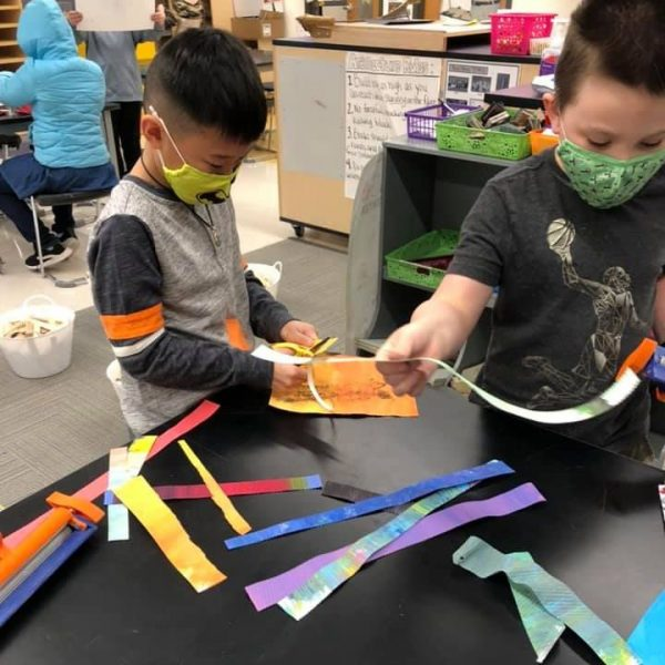 Affton School District students Jayson and Connor try out the paper crimpers in the Gotsch Art Studio in February 2021.