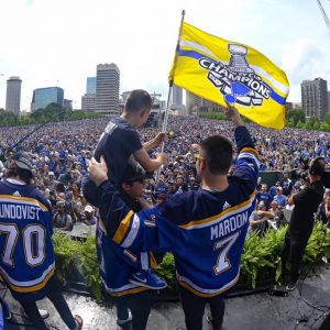 Oakville native Pat Maroon (No. 7, right) waves at the crowd of hundreds of thousands under the Arch and down Market Street at the Blues' Stanley Cup parade Saturday. Maroon's son Anthony, 10, sits on the shoulders of player Jaden Schwartz, and Oskar Sundqvist (No. 70) is also pictured. The night the Blues won the Cup, Anthony said his father would bring it to Telegraph Road in Oakville.