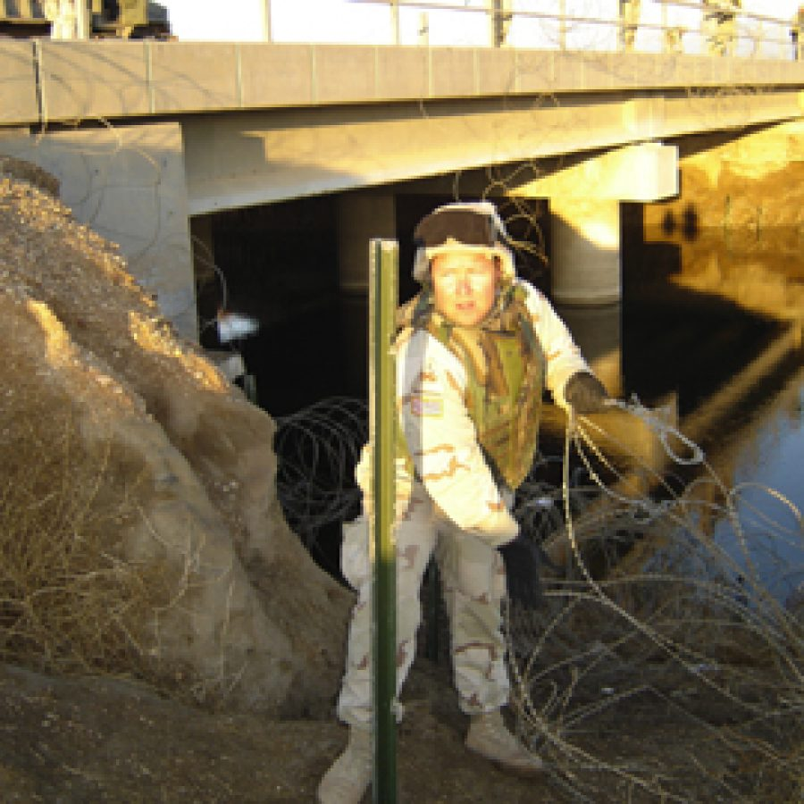 Rep. Jim Avery is shown setting up security on a bridge in Iraq as part of his duties with the National Guard's 1140th Engineering Battalion.