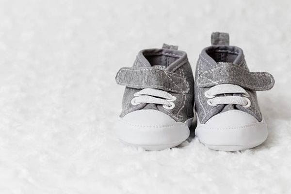 Image of a pair of grey baby shoes