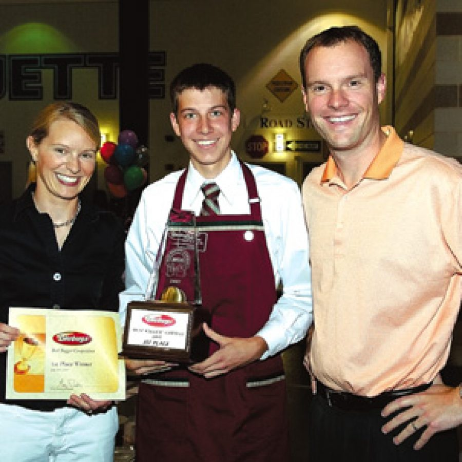 Laura Dierberg Padousis and Greg Dierberg present Andrew Stith with Dierbergs 2007 Best Bagger Award.