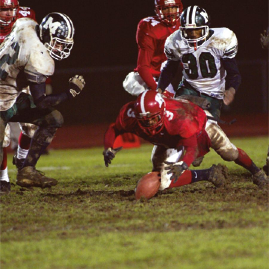 Kirkwood running back Chris Baker 3 covers a backfield fumble to keep a third-quarter drive alive deep in Mehlville territory during Kirkwood's 56-28 win Friday night.