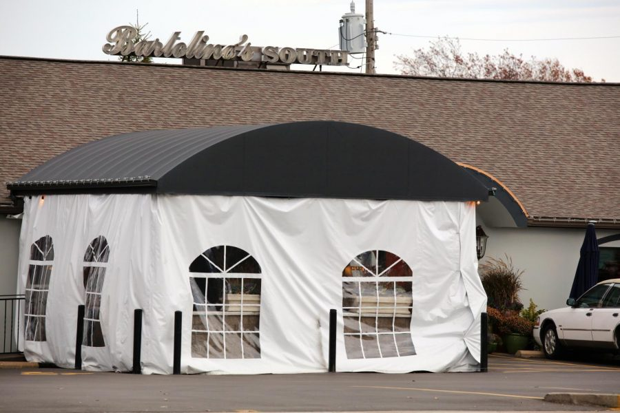 Bartolino's South has erected a tent outside to provide outdoor seating. But so far, the restaurant has stayed open inside despite an indoor dining ban.