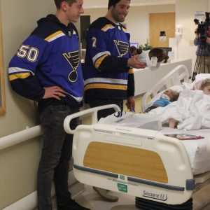 St. Louis Blues players including then-player and Oakville native Patrick Maroon, right, and Jordan Binnington visit with a patient at Cardinal Glennon Children