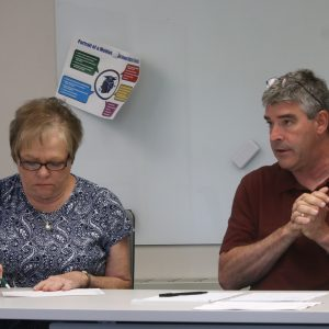 Mehlville Board of Education member Jean Pretto and CFO Marshall Crutcher discuss the 2020 budget during a meeting June 5, 2019 at Mehlville High School.