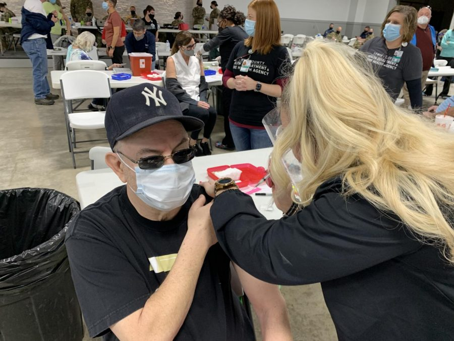 The Call's General Manager Bill Milligan, left, gets the COVID-19 vaccine at a mass vaccination event Feb. 23 in Canton, Missouri, population 2,377. Milligan traveled from South County, population of more than 100,000, which had not had a single mass vaccine event at press time.