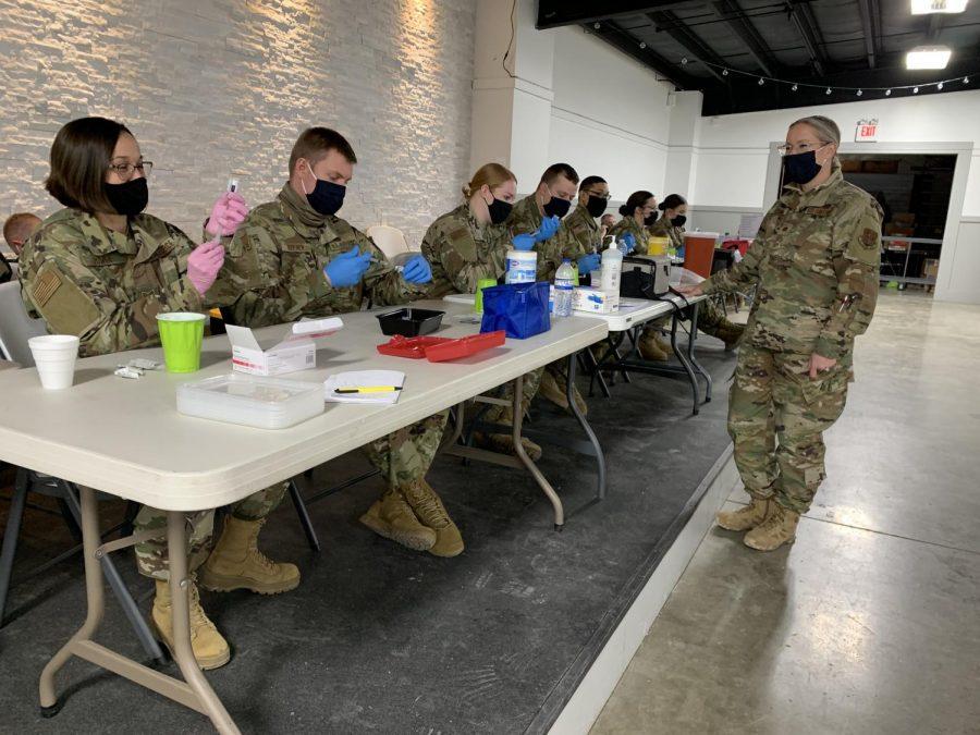 Members of the Missouri National Guard prepare doses of COVID-19 vaccine Feb. 23 in Canton, near the Iowa border.