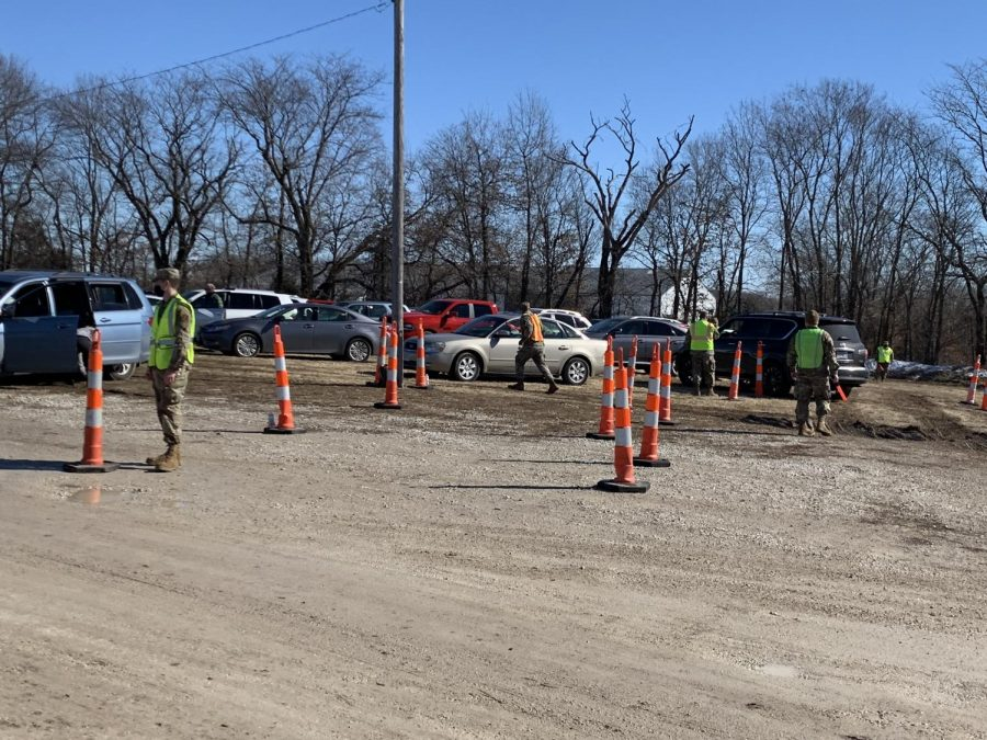 The National Guard directs traffic at a mass vaccination event in Canton, Feb. 23.