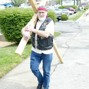 James Laughlin of Oakville carries a cross of his own making along Telegraph Road outside the sanctuary. Photo by Bill Milligan.