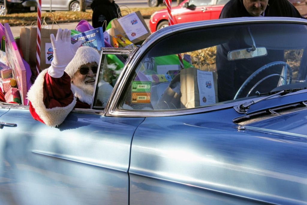 Santa Claus leads the classic car parade during the Christmas in Crestwood celebration in 2018.
