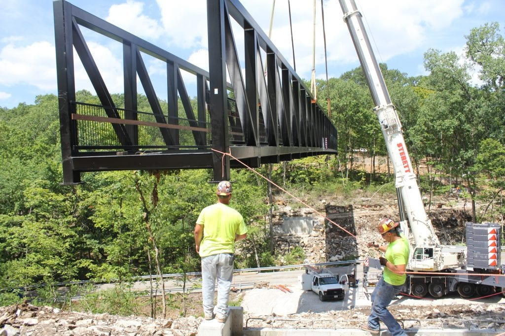 Workers+lower+one+of+the+largest+pedestrian+trail+bridges+in+St.+Louis+County+into+place+at+Cliff+Cave+Park+in+Oakville+in+July.