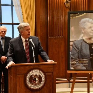 Gov. Mike Parson, above, hosted the largest crowd in his office so far to see him sign a bill renaming Lindbergh for the late Rep. Cloria Brown.