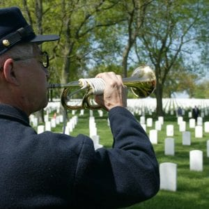 Marc Garcia plays the trumpet at the Jefferson Barracks National Cemetery ceremony. Photo by Bill Milligan.