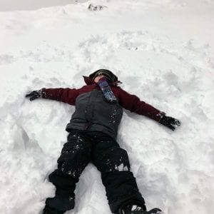 Cooper Jennings makes  a snow angel on a snow day off from school in January 2019.