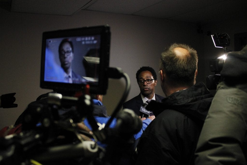 Wesley+Bell%2C+center%2C+takes+questions+from+reporters+after+being+sworn+in+as+St.+Louis+County+Prosecutor+on+Tuesday%2C+Jan.+1.+Bell+has+already+faced+criticism+for+the+decisions+he+made+his+first+few+days+in+office.+Photo+by+Erin+Achenbach.+