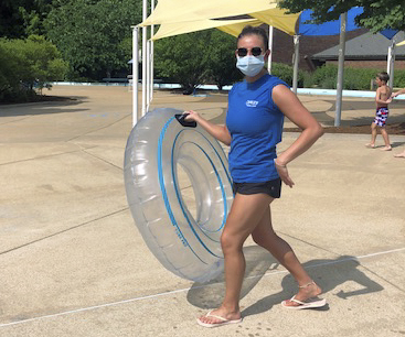 An employee wears a mask at the newly reopened Crestwood pool, as seen June 19.