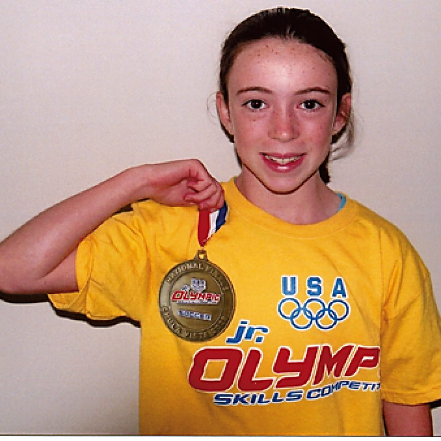 Kate Daus of Concord proudly displays the gold medal she won for her soccer skills at the Junior Olympics Skills Competition that took place last month in Chula Vista, Calif.