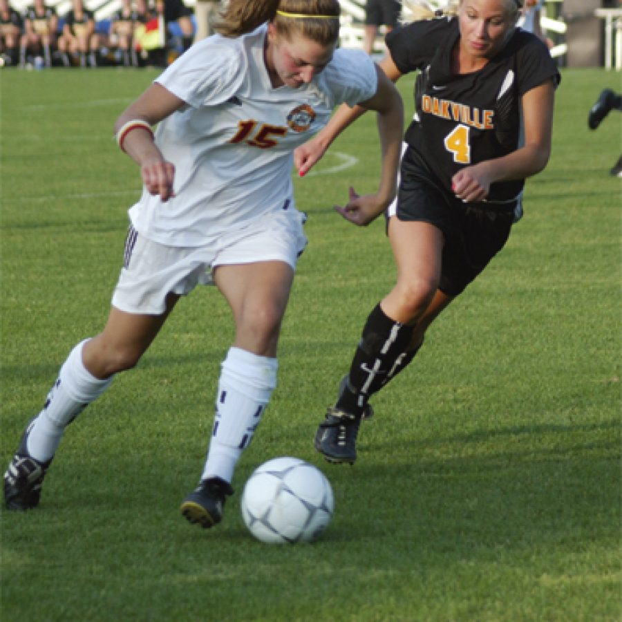 Oakville High senior defender Lauren Dieckmann, No. 4 in the photograph to the left, chases Incarnate Word's Jenny Kates, No. 15, to keep her from centering a pass to teammates waiting near the goal Saturday during state semifinal soccer action at Soccer Park in Fenton.