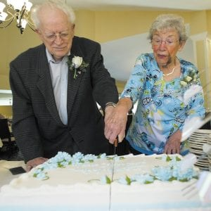 Bethesda Terrace residents James and Dorothy Kargus cut the cake during a reception in honor of their wedding.