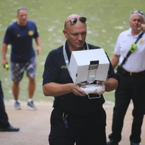 Drone operator Roman Stolarski pinpoints where on the Meramec River the rescue boats need to go to save the 'victim.' Photo by Jessica Belle Kramer.