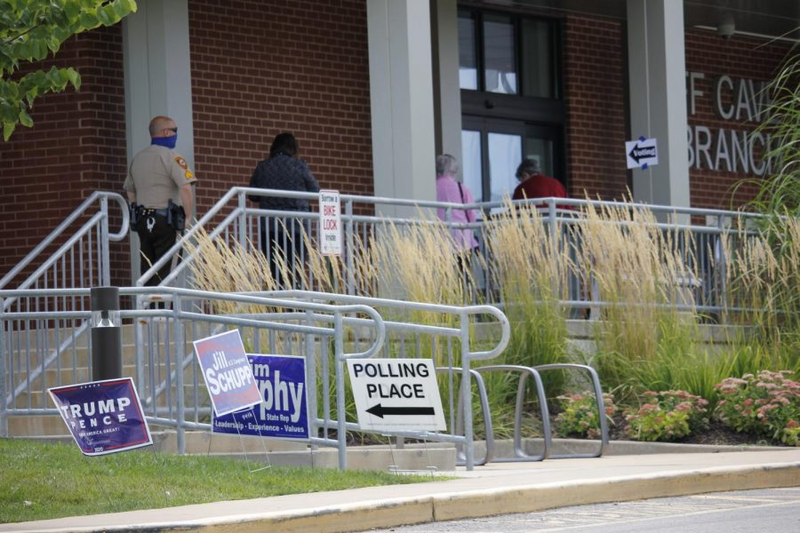 Voters line up outside Cliff Cave Library in Oakville Tuesday, Aug. 5, to vote in the primary election.