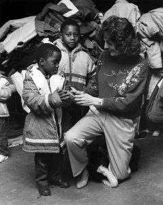 In this photo published by the St. Patrick Center on its 35th anniversary, Edith Cunnane talks to children at the center.