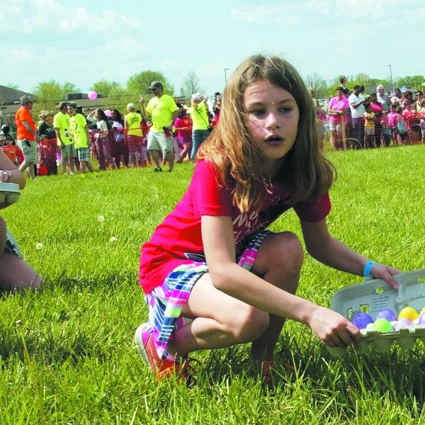 From 2017: Hundreds of children flocked to Canaan Baptist Church in Oakville on Saturday for the church's annual Egg Drop, as thousands of Easter eggs were dropped from a helicopter for children to collect. Besides eggs, the event featured games, bounce houses and food trucks. Above, Jenna Brinkman collects her eggs. Photo by Bill Milligan.