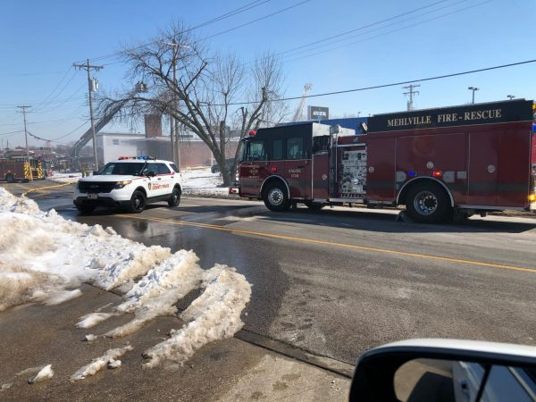 The St. Louis County Police Department and the Mehlville Fire Protection District are shown at the scene of the fire at the vacant building that was once Eime Hardware Saturday, Feb. 20, 2021.