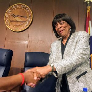 County Councilwoman Hazel Erby shakes the hand of a supporter who told her