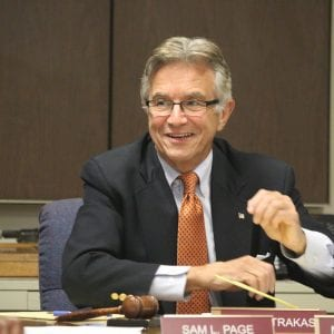 6th District Councilman Ernie Trakas laughs after Stinson attorney Andrew Scavotto repeatedly refuses to answer questions posed by the Council pertaining to Stinson's clients during the Ethics Committee meeting July 24. Photo by Jessica Belle Kramer.