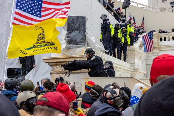Police confront pro-Trump rioters at the U.S. Capitol on January 6, 2021 (photo by Alex Kent).