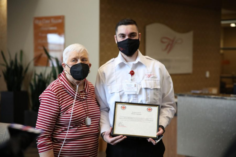 Friendship Village security officer Brandon Soehngen, right, was honored by the Fenton Fire Protection District in February for his quick response to a fire in the apartment of resident Gloria King, left, last December.