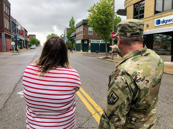 Representatives of the St. Louis Area Foodbank and the Missouri National Guard survey the drop off site on Locust Street for the Fill Up the Pickup Challenge this Saturday.