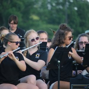 Flutists Samantha Kern, Cara Darmody and Catherine Elking play the 'Service Song Medley' at the Oakville Tiger Band concert June 1 at St. Bernadette. The event helped fundraise for the Marching Tigers' trip to perform in France in 2019. Photo by Jessica Belle Kramer.