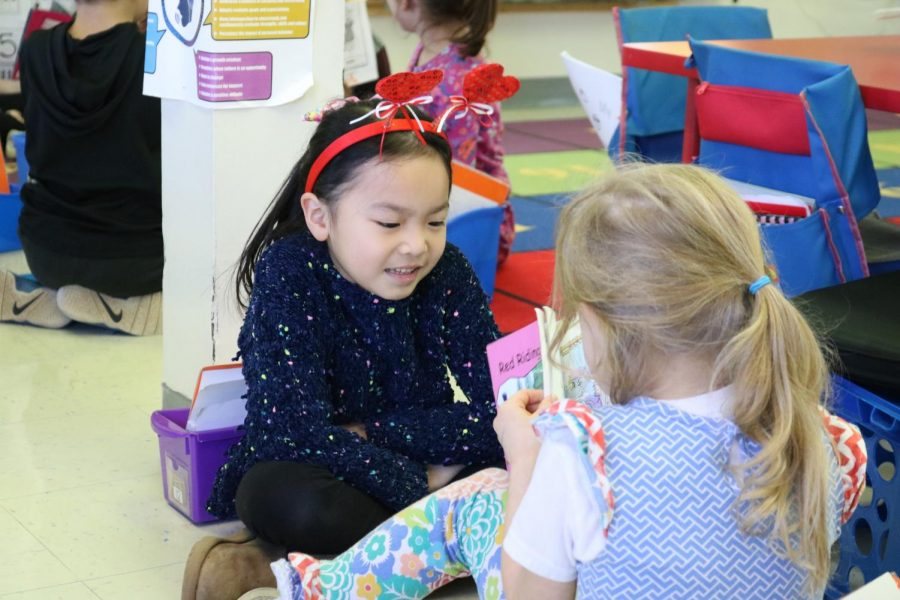 Kindergarten+students+at+Forder+Elementary+are+shown+here+during+a+school+activity+in+February+2020+where+they+paired+for+reading%2C+and+whenever+they+got+to+an+emotion+in+the+book%2C+they+would+have+to+make+a+face+to+show+their+partner+what+emotion+they+were+feeling.+Their+partner+would+try+to+guess+the+emotion.