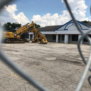 The construction fence and  now-vacant parking lot at Franview Plaza at the site where Sentinel Emergency Solutions will build its company headquarters, as seen Tuesday, July 2. Photo by Erin Achenbach.