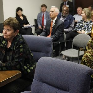 Board of Freeholder appointee Carol Stoker and, pictured behind her in an orange tie, appointee Dr. Alex Garza. Photo by Erin Achenbach.