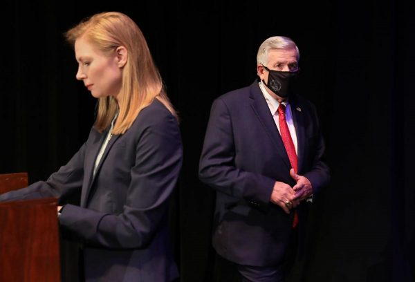 Gov. Mike Parson enters the stage, passing State Auditor Nicole Galloway before the Missouri gubernatorial debate at the Missouri Theatre in Columbia on Friday, Oct. 9, 2020 (Robert Cohen for the St. Louis Post-Dispatch)