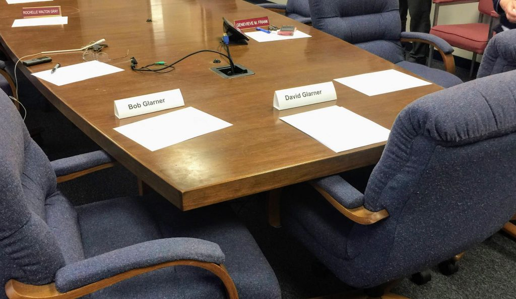 The+nametags+of+Bob+and+David+Glarner+in+front+of+their+empty+chairs+at+the+Ethics+Committee+hearing.+Photo+by+Gloria+Lloyd.