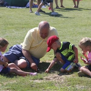 Ed Jackson plays with grandchildren Luke, 4, and twins Emma and Lil, 3, during the Tower Tee farewell concert in July 2018. Photo by Jessica Belle Kramer.