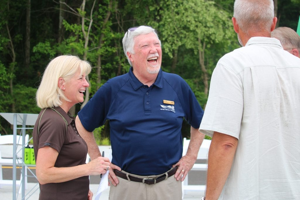 Great Rivers Greenway CEO Susan Trautman and board President Jim Hall mingle with guests at the June ribbon cutting.