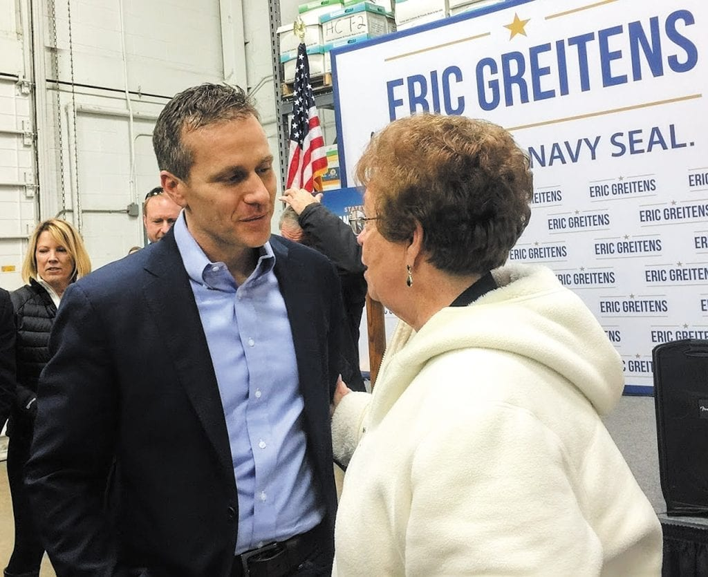 Gov.+Eric+Greitens%2C+left%2C+talks+to+south+county+resident+and+former+Rep.+Earlene+Judd+in+St.+Louis+County+the+day+before+he+was+inaugurated+earlier+this+year.+Photo+by+Gloria+Lloyd.