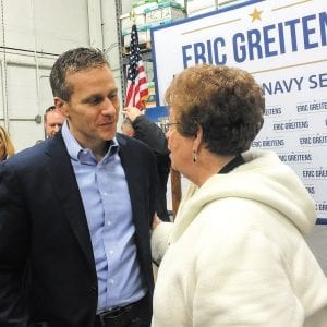 Gov. Eric Greitens, left, talks to south county resident and former Rep. Earlene Judd in St. Louis County the day before he was inaugurated earlier this year. Photo by Gloria Lloyd.