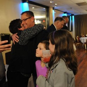 Mehlville Proposition R organizer Kimberly Hanan-West hugs Assistant Superintendent Jeff Bresler after seeing the first results at the Prop R victory party in November 2015. In the background, Superintendent Chris Gaines looks at election results with Dan Fowler.