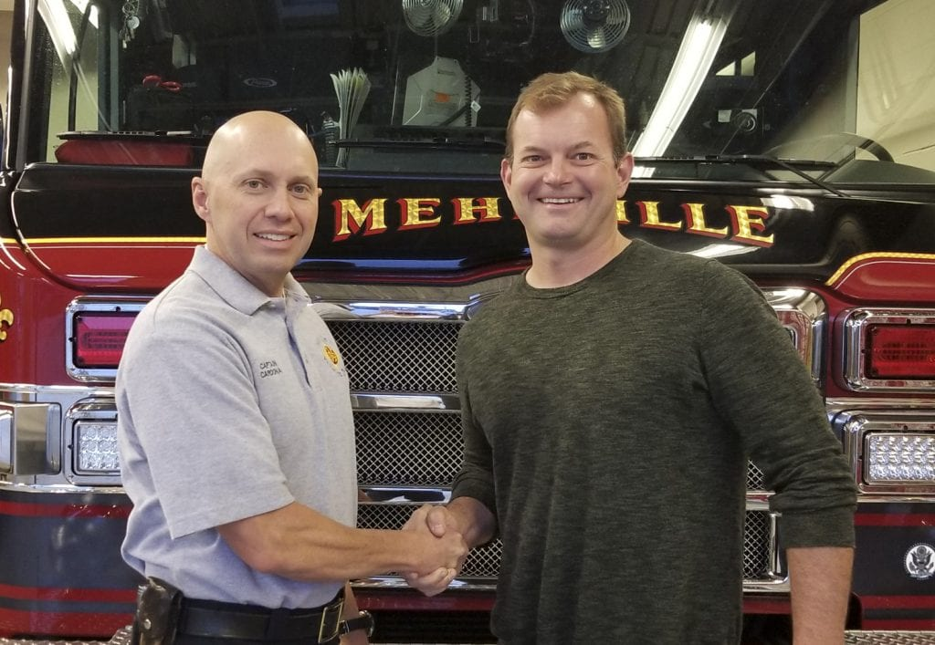 Mehlville+Fire+Protection+District+Capt.+Ty+Cardona%2C+left%2C+shop+steward+of+Mehlville+Local+2665+of+the+International+Association+of+Fire+Fighters%2C+shakes+hands+with+Board+of+Directors+Chairman+Aaron+Hilmer%2C+signaling+a+new+era+of+cooperation+between+the+union%2C+the+board+and+district+administration.