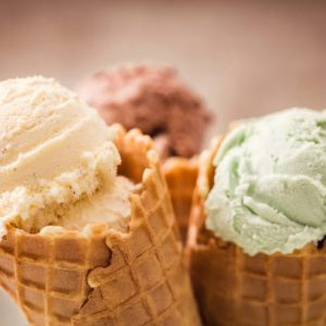 Homemade vanilla, chocolate and pistachio ice cream in a cone