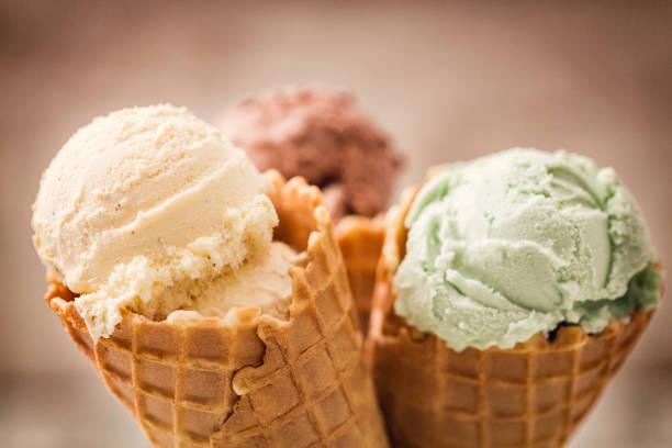 Homemade+vanilla%2C+chocolate+and+pistachio+ice+cream+in+a+cone