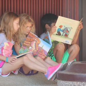 Incoming second-grader Aubrey Nicholson, first-grader Makenna Kessler and second-grader Moussa Moftin read their brand new books-together at the Bring Me a Book event in 2018.